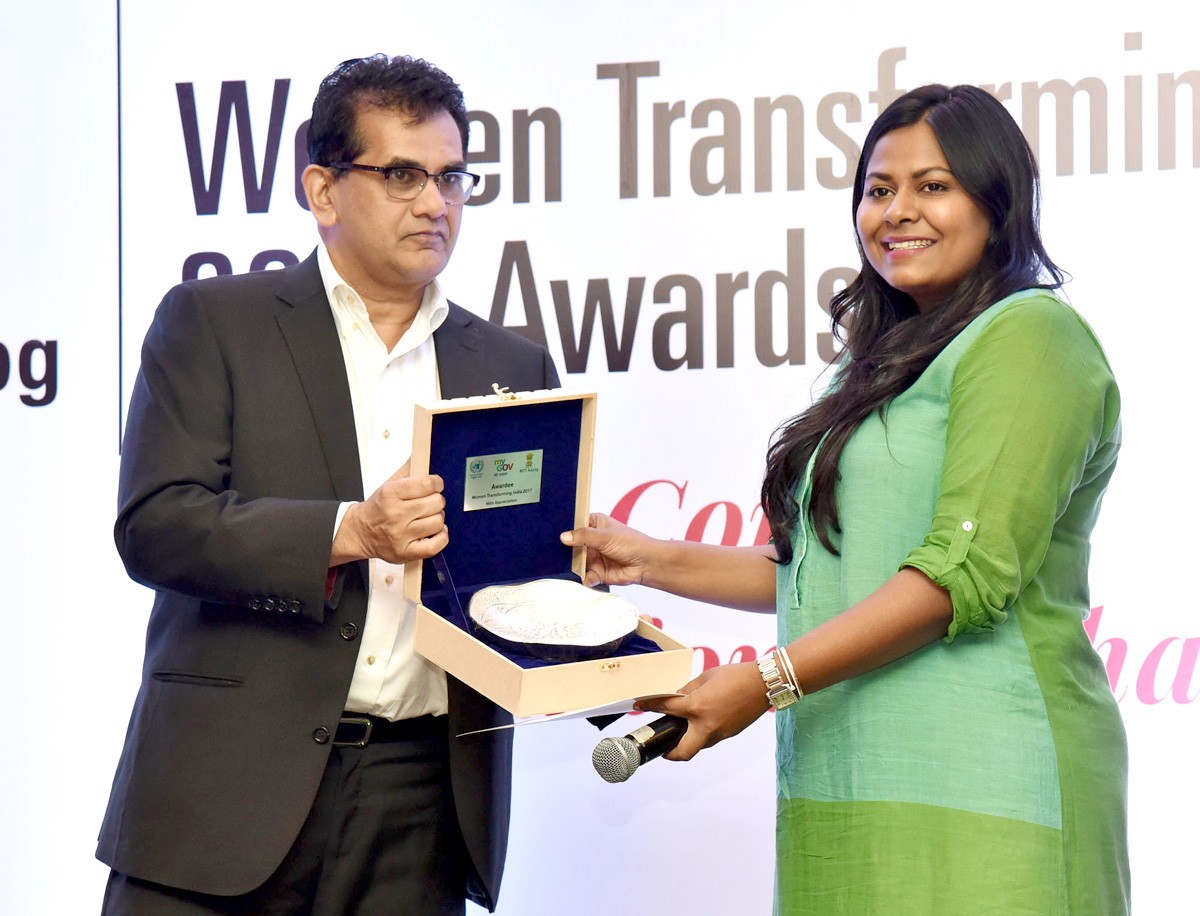 The CEO, NITI Aayog, Amitabh Kant presenting the 'Women Transforming India Award 2017' to Ms. Kanika Tekriwal (Madhya Pradesh) - Air Taxies out of Jet Planes, organised by the NITI Aayog, in New Delhi on August 29, 2017.